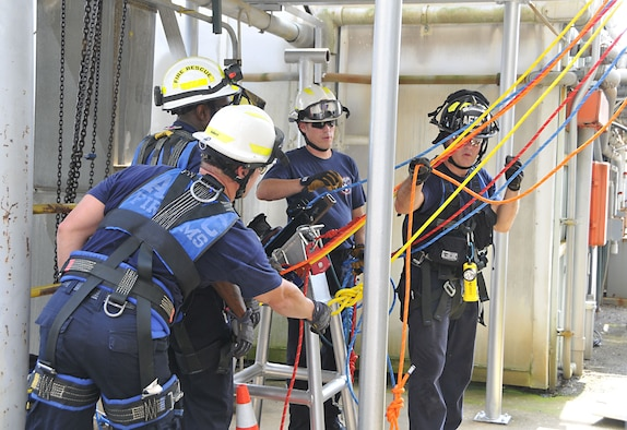 Members of the Arnold Fire and Emergency Services rig a 260-foot lift using a power winch during an exercise at the J-4 Rocket Motor Test Facility at Arnold Air Force Base. The winch allows firefighters to raise or lower a victim quickly and safely. (U.S. Air Force photo/Jacqueline Cowan)