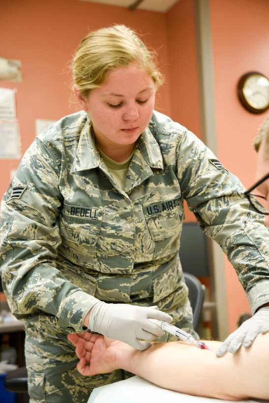 Senior Airman Kaydra Hart-Bedell inserts an IV on a patient at the Tripler Army Medical Center emergency room Jan. 17, 2018, Honolulu, HI.