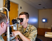 Capt. Brian Gill, 114th Medical Group optometrist, performs an eye exam on a patient at Schofield Health Clinic Jan. 17, 2017, Wahiawa, HI.