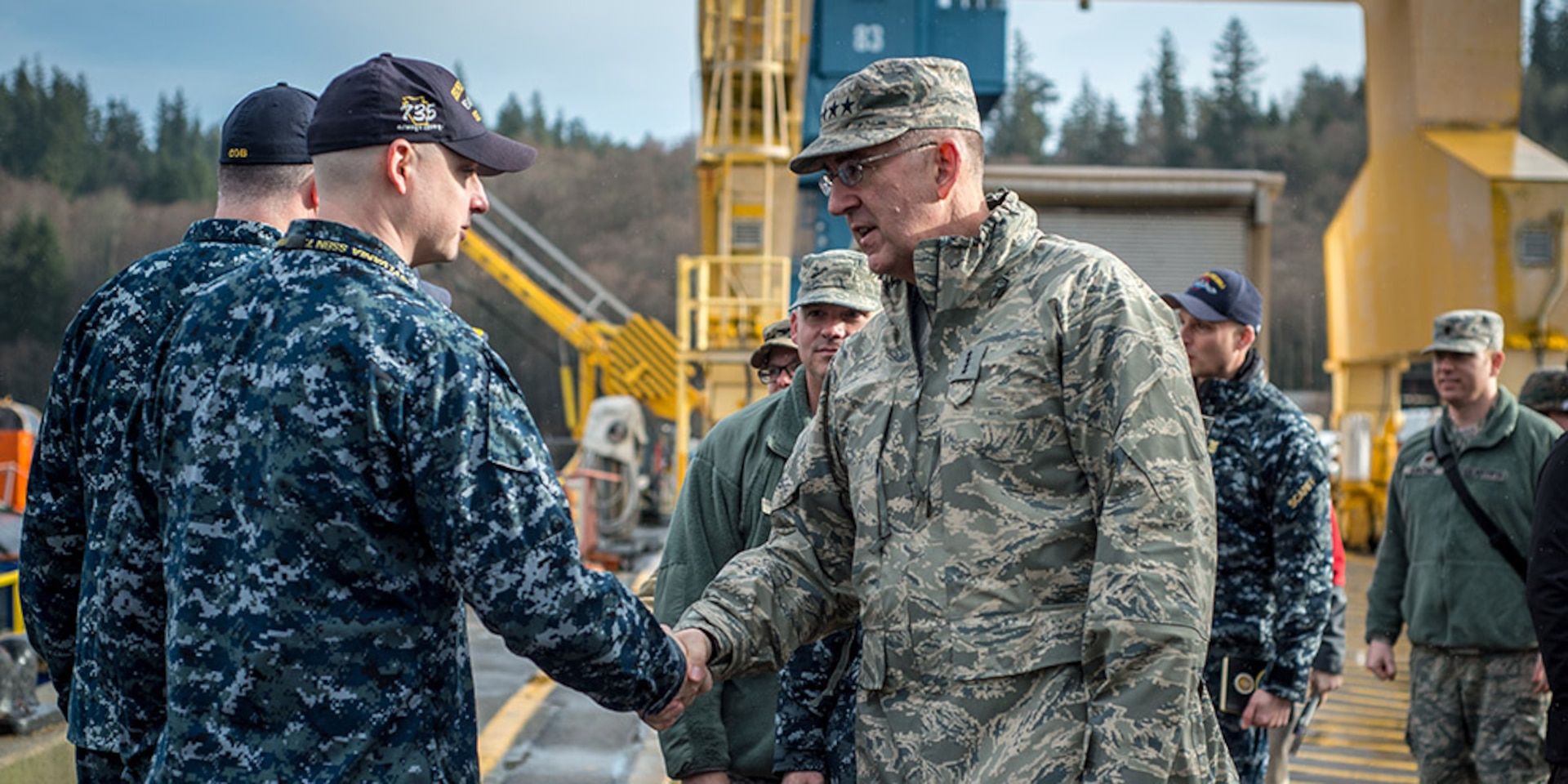 BANGOR, Wash. (Jan. 18, 2018) - U.S. Air Force Gen. John Hyten (right), commander of U.S. Strategic Command, arrives at the Ohio-class ballistic missile submarine USS Pennsylvania (SSBN 735) and shakes hands with Gold Crew Chief of the Boat, U.S. Navy, Master Chief Missile Technician (SS) Petty Officer Dylan Lapinski, at Naval Base Kitsap-Bangor, Wash., Jan 18, 2018. Hyten visited staff and facilities assigned to Commander Submarine Group 9  to see the operations of one leg of the nuclear triad.
