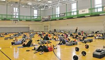 Dozens of participants occupy the floor of the basketball court for a Body Pump class during New Year's Fitness Round Robin at Whitside Fitness Center Jan. 6.