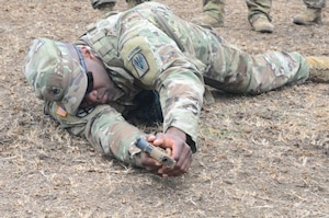 rmy Staff Sgt. Curtis Graham demonstrates how to properly shoot the new XM17 pistol from the prone position at the Joint Readiness Training Center at Fort Polk, La.