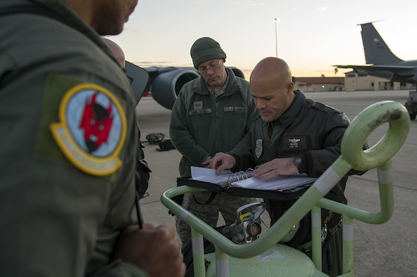 U.S. Air Force Lt. Col. Ricardo Lopez, the 50th Air Refueling Squadron (ARS) commander, reviews the aircraft documentation before taking off for the first 50th ARS's training mission at MacDill Air Force Base, Fla., Jan. 16, 2018. The 50th ARS brought with it eight new aircraft to MacDill, expanding Air Mobility Command's global reach. (U.S. Air Force photo by Airman 1st Class Caleb Nunez)