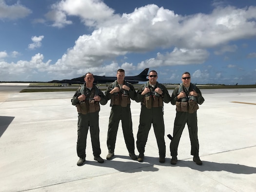 Col. John R. Edwards, the 28th Bomb Wing Commander, stands with other B-1 Bomber aircrew members from the 37th Bomb Squadron at Anderson Air Force Base, Guam. Ellsworth deployed Airmen from the 37th BS to help with the Continuous Bomber Presence operation that is being conducted by the Air Force Pacific Command. (Courtesy photo)