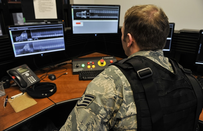 Staff Sgt. Austin Sweet, 628th Security Forces Squadron patrolman, inspects a truck attempting to gain base access through Z-Portal scans Jan. 12, 2018, at Joint Base Charleston, S.C. The Z-Portal takes X-rays of vehicles to show security forces members the vehicle's contents. It allows them to see weapons inside the vehicle.