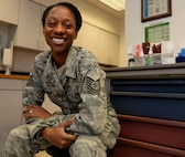 Tech. Sgt. Shanelle I. Sampson, the flight medical technician assigned to the 64th Air Refueling Squadron, poses for a portrait on Jan. 12, 2018, at Pease Air National Guard Base, N.H. Sampson was one of a select number of Airmen within the Air Mobility Command to receive a step promotion in 2017. (N.H. Air National Guard photo by Staff Sgt. Kayla Rorick)