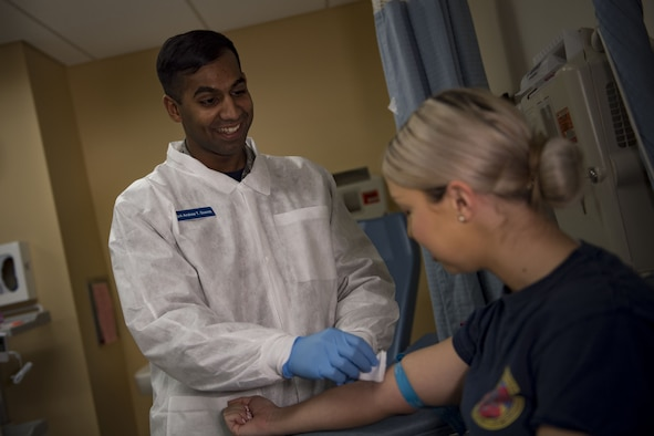 Senior Airman Andrew Soares, 23d Medical Support Squadron medical laboratory technician, draws blood from a simulated patient, Jan. 19, 2018, at Moody Air Force Base, Ga. The Biomedical Science Corps became the most diverse corps in the Air Force Medical Services when the Chief of Staff of the Air Force signed a special order on Jan. 28, 1965. (U.S. Air Force photo by Senior Airman Daniel Snider)