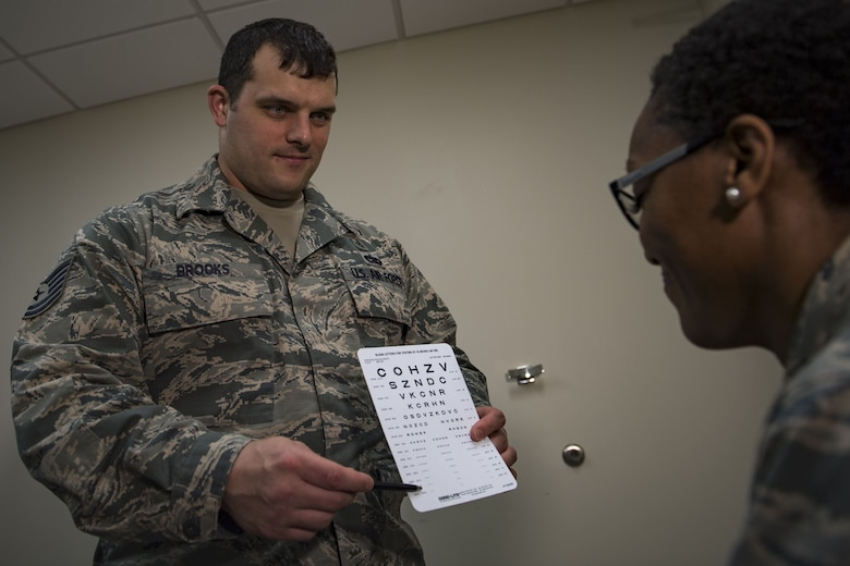 Tech. Sgt. Neal Brooks, 23d Aerospace Medicine Squadron administers a vision test, Jan. 19, 2018, at Moody Air Force Base, Ga. The Biomedical Science Corps became the most diverse corps in the Air Force Medical Services when the Chief of Staff of the Air Force signed a special order on Jan. 28, 1965. (U.S. Air Force photo by Senior Airman Daniel Snider)