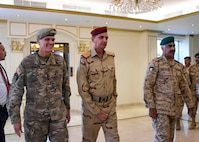 U.S. Army Gen Joseph L. Votel, commander, U.S. Central Command, meets with Gen Othman al-Ghanimi, Chief of Staff, Iraqi Army, and Lt Gen Mohammed Khaled Al-Khadher, Chief of Staff, Kuwait armed forces, January 23, 2018. Votel met with key military leaders at the US, Iraq, and Kuwait Chief of Staff tri-lateral discussions during his recent USCENTCOM area of responsibility trip. (U.S. Air Force photo by Tech Sgt. Dana Flamer)