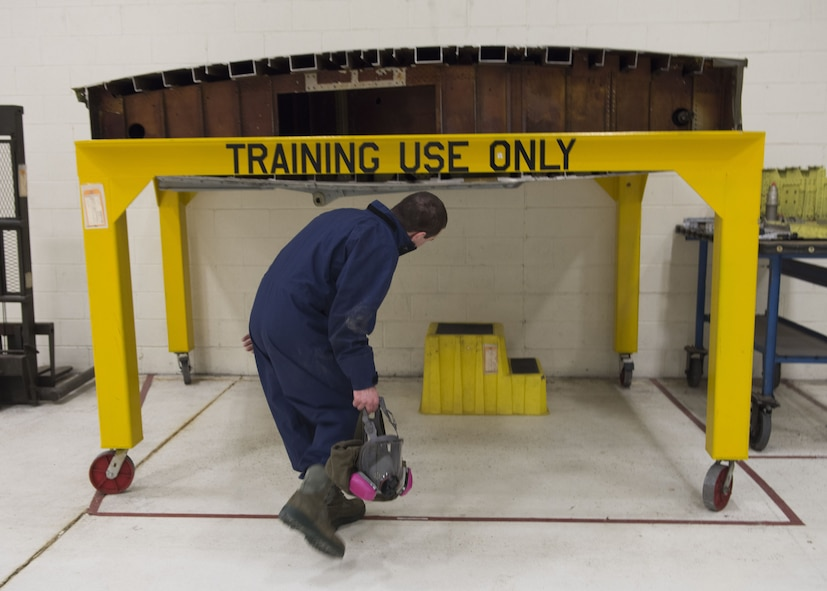 Airman 1st Class Elijah Simmons, 92nd Maintenance Squadron, Aircraft Fuel Systems Squadron apprentice, prepares to enter a fuel tank training module, a section of a former KC-135 Stratotanker wing, during a training session at Fairchild Air Force Base, Washington, Nov. 21, 2017. Fuel leaks on an aircraft can be a disaster mid-air or prevent an aircraft from possessing enough fuel pressure to even take off, making it a critical part of maintenance. (U.S. Air Force photo/Senior Airman Ryan Lackey)
