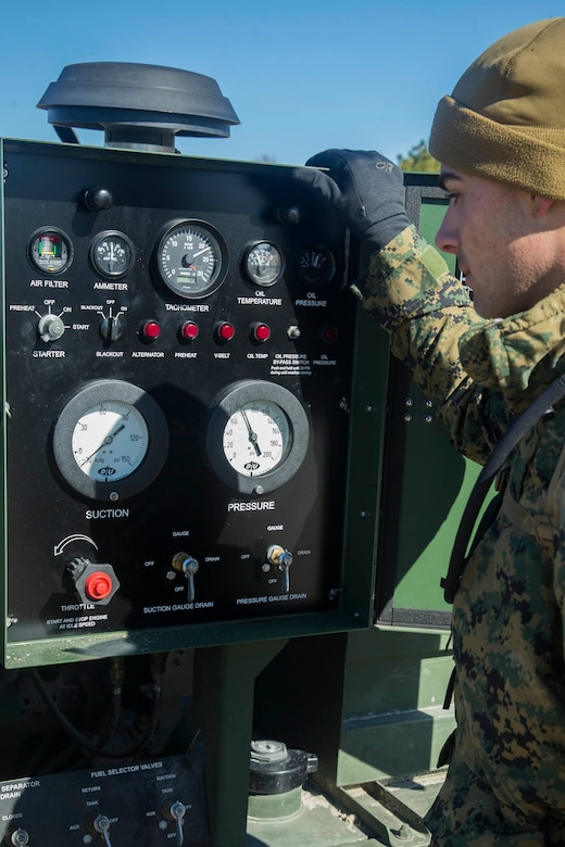 U.S. Marine Corps Cpl. Tyler M. Sampson, Bulk Fuel Specialist, Bulk Fuel Company, 8th Engineer Support Battalion, 2nd Marine Logistics Group, observes a Tactical Fuel System during a training exercise held at Engineer Training Area 2 aboard Camp Lejeune, N.C., Jan. 12, 2018. The exercise was designed to increase proficiency while sustaining ground readiness and combat capability of II Marine Expeditionary Force. (U.S. Marine Corps photo by Lance Cpl. Tyler W. Stewart)