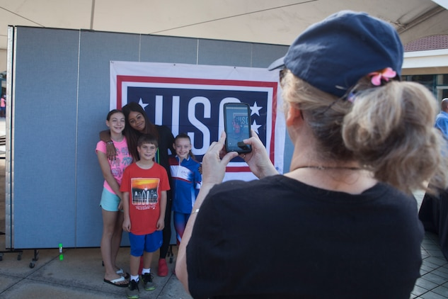 Olympic medalist visits mcbh for final uso stop tour marine corps young fans pose for a photo with gabrielle gabby douglas during a united services m4hsunfo