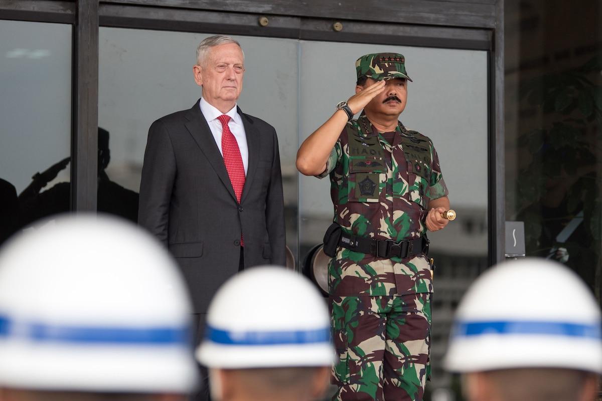Defense Secretary James N. Mattis stands beside Indonesian Defense Chief Marshal Hadi Tjahjanto.