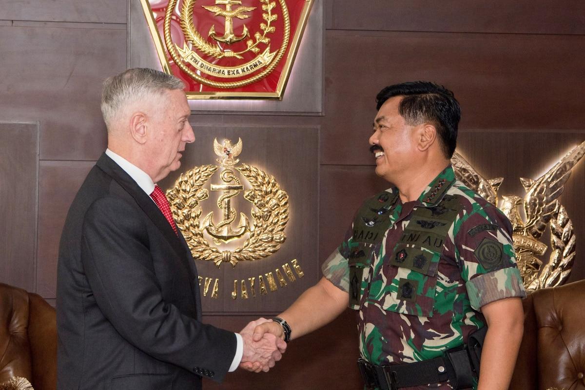 Defense Secretary James N. Mattis shakes hands with Indonesian Defense Chief Marshal Hadi Tjahjanto.