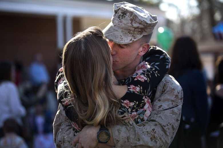 U.S. Marines and sailors assigned to Task Force Southwest are greeted by friends and family after returning from a nine-month deployment to Helmand Province, Afghanistan Jan. 21, 2018 on Marine Corps Base Camp Lejeune, N.C. The Task Force of roughly 300 personnel from II Marine Expeditionary Force deployed in Spring of 2017 in support of the NATO-led Resolute Support mission. Led by Brig. Gen Roger B. Turner, the Task Force trained and advised key leaders within the Afghan National Army 215th Corps and the 505th Zone National Police. The redeployment of the Marines and sailors is the largest since 1st Battalion, 2nd Marines concluded the Marine Corps' combat role in Afghanistan in late 2014. They transferred authority to a new rotation of Marines, led by Brig. Gen. Benjamin T. Watson, at Camp Shorab, January 15, 2018. (U.S. Marine Corps photo by Sgt. Matthew Callahan)