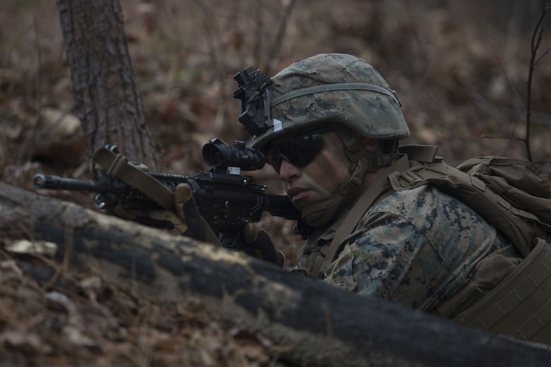 Lance Cpl. Branson Benavidez, a Marine with 2nd Battalion, 8th Marine Regiment, posts security during a patrol at a platoon live-fire range during a deployment for training exercise at Fort A.P. Hill, Va., Dec. 7, 2017. The Marines are conducting the training to maintain proficiency at the squad, platoon, company, and battalion-level of warfighting in preparation for an upcoming deployment to Japan. The Marines patrolled, detonated Bangalore torpedoes to breach obstacles, threw M67 fragmentation grenades to clear trenches, and conducted live-fire movements to take an objective. (U.S. Marine Corps photo by Lance Cpl. Ashley McLaughlin)