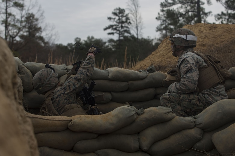 A Marine with 2nd Battalion, 8th Marine Regiment throws an M67 fragmentation grenade at a platoon live-fire range during a deployment for training exercise at Fort A.P. Hill, Va., Dec. 7, 2017. The Marines are conducting the training to maintain proficiency at the squad, platoon, company, and battalion-level of warfighting in preparation for an upcoming deployment to Japan. The Marines patrolled, detonated Bangalore torpedoes to breach obstacles, threw M67 fragmentation grenades to clear trenches, and conducted live-fire movements to take an objective. (U.S. Marine Corps photo by Lance Cpl. Ashley McLaughlin)