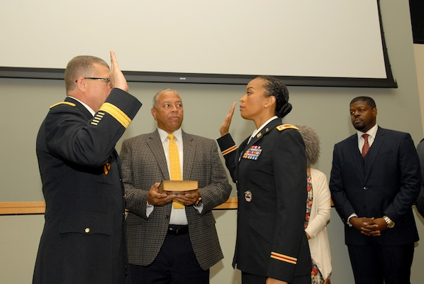 Army Lt. Col. Corrinne Bell, right, reaffirms the oath of the commissioned officer with Brig. Gen. Mark Simerly, commander, during a promotion ceremony at DLA Troop Support in Philadelphia Jan. 19, 2018.