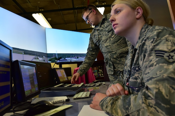 Senior Airman Gabriella Bellou, 19th Operations Support Squadron air traffic control journeyman, and Airman 1st Class Kyle Hood, 19th OSS air traffic control apprentice, use a simulator to assist Hood in his upgrade training Jan. 10, 2018, at Little Rock Air Force Base, Ark. The simulator is the primary tool used in air traffic control upgrade training, which can take up to a year. (U.S. Air Force photo by Airman 1st Class Rhett Isbell)