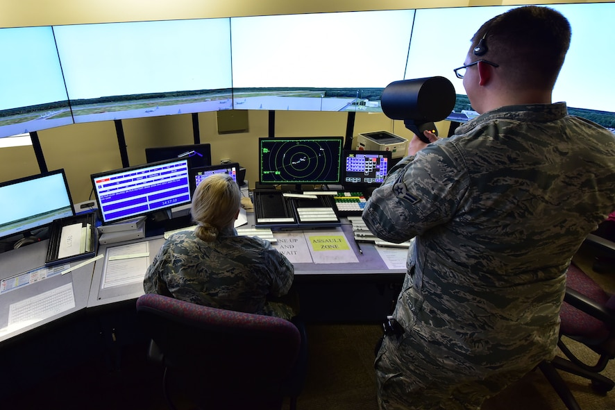 Senior Airman Gabriella Bellou, 19th Operations Support Squadron air traffic control journeyman, supervises Airman 1st Class Kyle Hood, 19th OSS air traffic control apprentice, as he uses a light gun to simulate signaling a plane which is unable to hear him over their normal lines of communication Jan. 11, 2018, at Little Rock Air Force Base, Ark. The light gun uses the colors: red, green and yellow to communicate with inbound aircraft. (U.S. Air Force photo by Airman 1st Class Rhett Isbell)