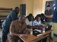 AFOSI SA Clayton Drown works with Nigerian counterparts to draft a real-world threat assessment in Niamey, during the inaugural DTAMS in Niger conducted by the AFOSI 25 EFIS Dec. 11-14 and 19-22, 2017. (Photo submitted by SA Helen Marino)