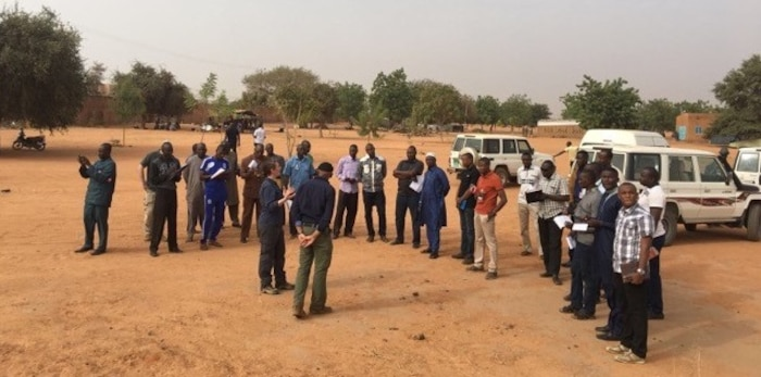 AFOSI 25 EFIS Op Officer SA Helen Marino discusses security with Nigerian counterparts in Niamey, Niger, as part of the inaugural Defense Threat Assessment Methodology Seminar in Niger Dec. 11-14 and 19-22, 2017.