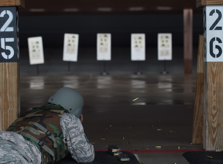U.S. Air Force Master Sgt. Daniel Young, 1st Aircraft Maintenance Squadron production superintendent, fires an M-4 Carbine at targets during training at the combat arms training and maintenance range at Joint Base Langley-Eustis, Va., Jan. 23, 2018.