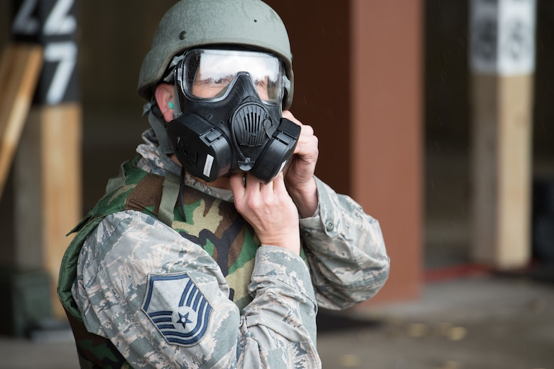 U.S. Air Force Master Sgt. Daniel Young, 1st Aircraft Maintenance Squadron production superintendent, dons a gas mask and helmet during training at the combat arms training and maintenance range at Joint Base Langley-Eustis, Va., Jan. 23, 2018.