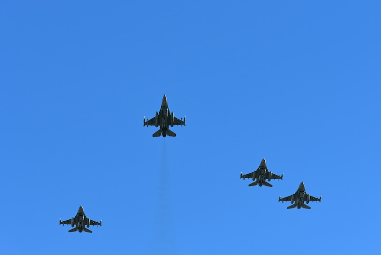 U.S. Air Force 20th Fighter Wing F-16CM Fighting Falcon pilots fly over a ceremony honoring late Col. Charles C. Heckel, a World War II prisoner of war, at Shaw Air Force Base, S.C., Jan. 19, 2018.