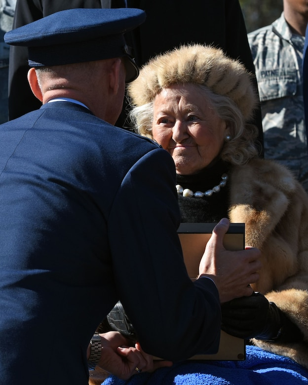 U.S. Air Force Col. Daniel Lasica, 20th Fighter Wing commander, presents Jacqueline Heckel with a Prisoner of War Medal for the sacrifices her late husband, Col. Charles C. Heckel, made as a World War II prisoner of war at Shaw Air Force Base, S.C., Jan. 19, 2018.