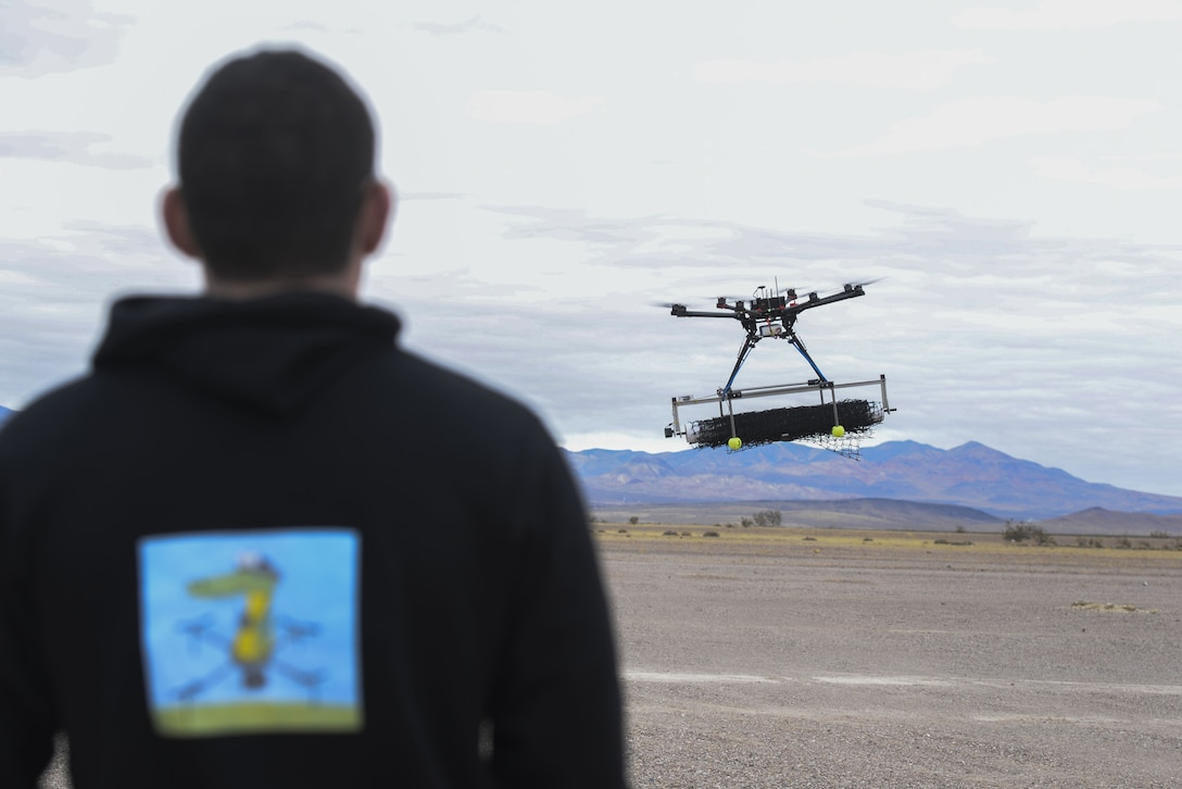 U.S. Air Force 2nd Lt. David Feibus, from Wright-Patterson Air Force Base, Ohio, fly's one his teams DJI S1000 drone during the setup and calibration phase of the event at the Nevada National Security Site, Las Vegas, NV., Dec. 9, 2016. This year teams were given the challenge of solving issues revolving around drones, and are demonstrating their solutions to judges. (U.S. Air Force photo by Wesley Farnsworth)