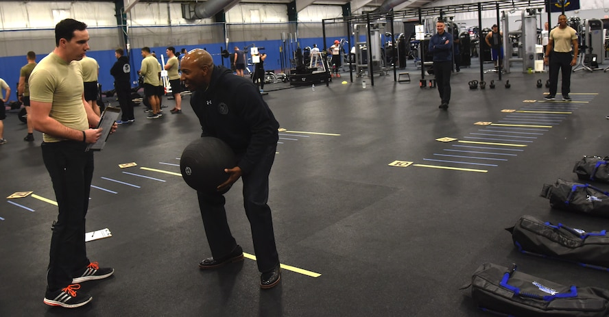 Chief Master Sergeant of the Air Force Kaleth O. Wright (second from left) poises to launch a medicine ball over his head at Joint Base Andrews, Md., Jan. 9, 2018. Wright visited a demonstration for a new occupational fitness program performed by senior noncommissioned officers from across the special  operations community. (U.S. Air Force photo by Staff Sgt. Joe Yanik)