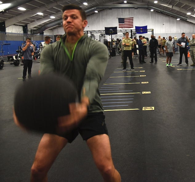 Master Sgt. Paul Foles, 17th Special Tactics Squadron, throws a medicine ball over his head during a strength and agility demonstration as part of the Air Force special operations community's new fitness assessment program at Joint Base Andrews, Md., Jan. 9, 2018. (U.S. Air Force photo by Staff Sgt. Joe Yanik)