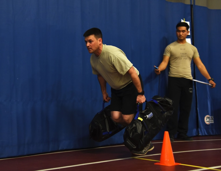 Master Sgt. James Blair, 12th Combat Training Squadron, performs a farmers drag during a strength and agility demonstration as part of the Air Force special operations community's new fitness assessment program at Joint Base Andrews, Md., Jan. 9, 2018. (U.S. Air Force photo by Staff Sgt. Joe Yanik)