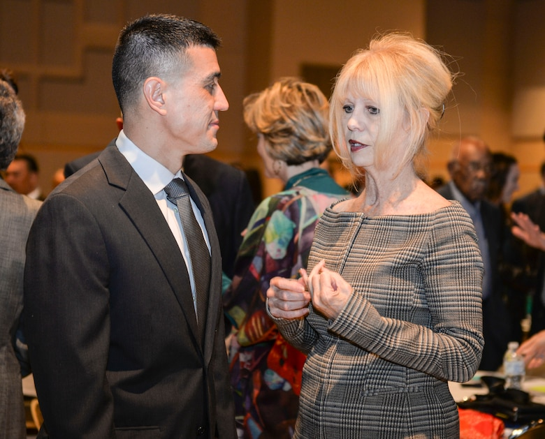 U.S. Air Force Col. Ricky Mills, 17th Training Wing commander, visits with San Angelo Mayor, Brenda Gunter, during the San Angelo Chamber of Commerce Annual Awards Banquet held at the McNease Convention Center, San Angelo, Texas, Jan. 23, 2018. Goodfellow Air Force Base partners closely with the San Angelo community leading the Air Force in partnership agreements. (U.S. Air Force photo by Aryn Lockhart/Released)
