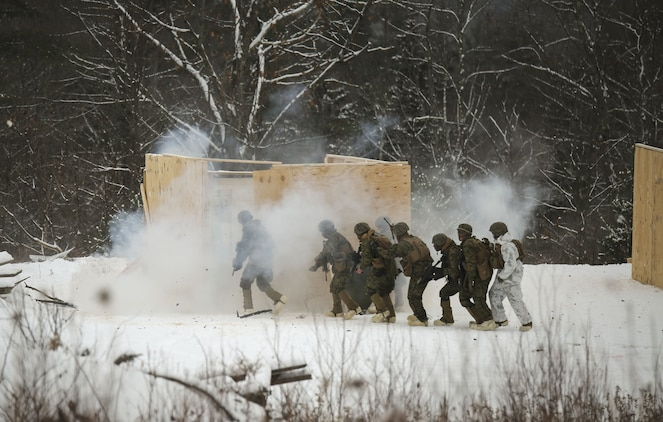 Marines with Company E, 4th Combat Engineer Battalion, 25th Marine Regiment, 4th Marine Division, breach and clear a building during exercise Nordic Frost at Camp Ethan Allen Training Site in Jericho, Vt., Jan. 19, 2018. The exercise allowed Marines to demonstrate their ability to operate in a cold weather mountainous environment, conducting land navigation, marksmanship training, demolitions, call for fire training and other core competencies. (U.S. Marine Corps photo by Pfc. Samantha Schwoch/released)