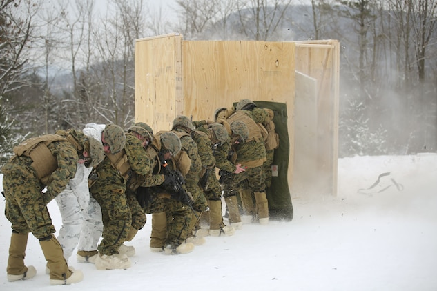 Marines with Company E, 4th Combat Engineer Battalion, 25th Marine Regiment, 4th Marine Division, take cover as a charge is used to breach a building during exercise Nordic Frost at Camp Ethan Allen Training Site in Jericho, Vt., Jan. 19, 2018. The exercise allowed Marines to demonstrate their ability to operate in a cold weather mountainous environment, conducting land navigation, marksmanship training, demolitions, call for fire training and other core competencies. (U.S. Marine Corps photo by Pfc. Samantha Schwoch/released)