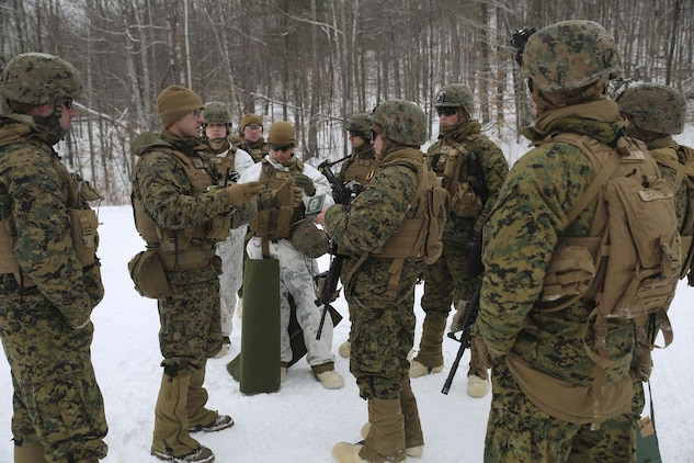 Capt. Clinton Snow, company commander of Company E, 4th Combat Engineer Battalion, 4th Marine Division, briefs Marines on the safety procedures before conducting breach training during exercise Nordic Frost at Camp Ethan Allen Training Site in Jericho, Vt., Jan. 19, 2018. The goal of Nordic Frost was to improve the unit's environmental capabilities by giving them an introduction to cold weather training and testing their squad and fire team level defensive proficiency in an austere environment. (U.S. Marine Corps photo by Pfc. Samantha Schwoch/released)