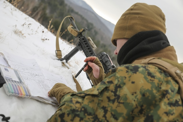 Lance Cpl. Christopher C. Acosta, team leader with Company C, 1st Battalion, 24th Marines, 25th Marine Regiment, 4th Marine Division, practice preparing range cards during exercise Nordic Frost on Camp Ethan Allen in Jericho, Vt., Jan. 20, 2018. The exercise enabled Reserve Marines to spend two weeks working together, battling the elements to ensure that they are ready to fight tonight and respond to the nation's calls. (U.S. Marine Corps photo by Pfc. Samantha Schwoch/released)