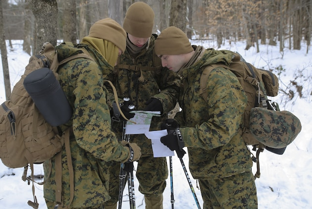 Marines with Company B, 1st Battalion, 24th Marines, 25th Marine Regiment, 4th Marine Division, conduct land navigation training during exercise Nordic Frost at Camp Ethan Allen Training Site in Jericho, Vt., Jan. 20, 2018. Nordic Frost enabled Reserve Marines to spend two weeks working together, battling the elements to ensure that they are ready to fight tonight and respond to the nation's calls. (U.S. Marine Corps photo by Pfc. Samantha Schwoch/released)
