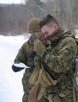 Lance Cpl. Gabriel Amezcua, left, and Pfc. Trenton White, right, riflemen with Company B, 1st Battalion, 24th Marines, 25th Marine Regiment, 4th Marine Division, conduct land navigation training during exercise Nordic Frost at Camp Ethan Allen Training Site in Jericho, Vt., Jan. 20, 2018. Nordic Frost enabled Reserve Marines to spend two weeks working together, battling the elements to ensure that they are ready to fight tonight and respond to the nation's calls. (U.S. Marine Corps photo by Pfc. Samantha Schwoch/released)