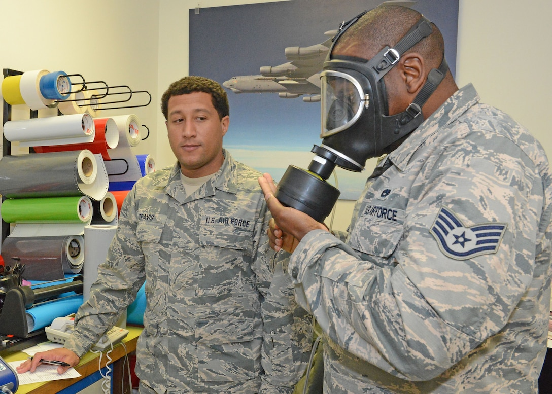 Staff Sgt. Andrew Travis, 412th Aerospace Medicine Squadron Bioenvironmental Engineering Team (left), observes Staff Sgt. Kenroy Steele, 412th Maintenance Squadron, testing the respirator filter cartridge on a mask at the 412th MXS Fabrication Flight Jan. 23. Airmen from Bioenvironmental dropped by on their annual check to make sure each member of the flight were properly trained on how to fit their different masks. The masks are used for various work on aircraft structures to include painting and corrosion treatment. A machine connected to the masks tested each member by having them simulate different behaviors and movements to ensure the masks fit properly. Supervisors from the Fabrication Flight said they appreciate the Bioenvironmental Engineering Team coming to them as it saves precious work time by not having each maintenance member go to the 412th AMDS for the annual check.