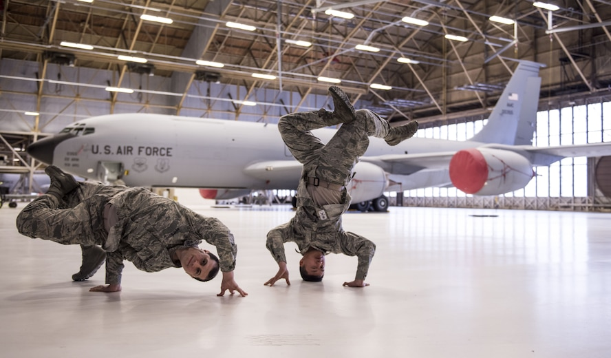 Capt. Juan Reyes, 92nd Air Refueling Wing chaplain, and Senior Airman Simon Vang, 92nd Maintenance Group analyst, break dance in front of a KC-135 Stratotanker, Fairchild Air Force Base, Wash., Jan. 18, 2018. Both Vang and Reyes started dancing in grade school and have fostered a passion for it, which in turn helps them with job performance and becoming more effective Airmen. (U.S. Air Force photo by Senior Airman Sean Campbell)