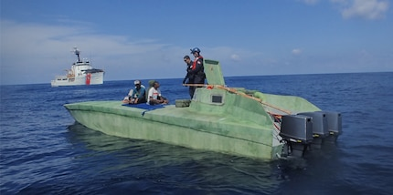 A Coast Guard boarding team members intercept a suspected Low Profile Vessel.