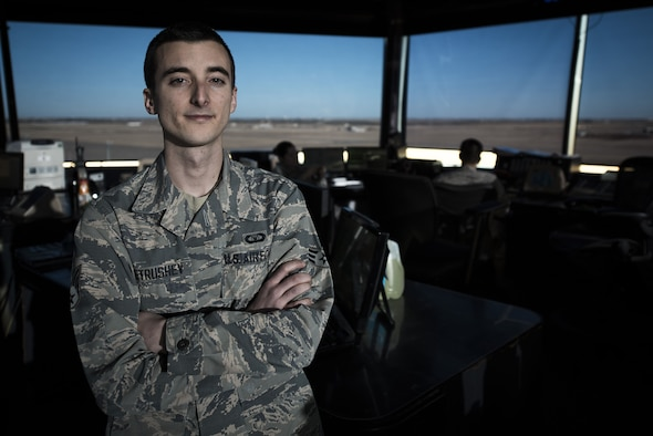 Senior Airman Daniel Petrushev, 27th Special Operations Support Squadron Air Traffic Controller, poses for a portrait in his work environment at Cannon Air Force Base, N.M., Jan. 24, 2017. Petrushev is expected to attend Officer Training School in April. He is aiming high to become a U.S. Air Force pilot, an opportunity crafted from years of striving for success, failing and getting back up again. (U.S. Air Force photo by Senior Airman Lane T. Plummer)