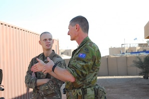 Medical soldiers from the United States and Australia discuss procedures during a mass-casualty exercise in Iraq.
