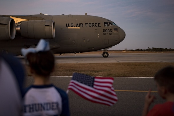 Families and friends wait for their loved ones to exit a C-17 Globemaster III during a redeployment, Jan. 23, 2018, at Moody Air Force Base, Ga. Airmen from the 74th Fighter Squadron and 23d Maintenance Group returned home after a seven-month deployment in support of Operation Inherent Resolve. (U.S. Air Force photo by Senior Airman Daniel Snider)