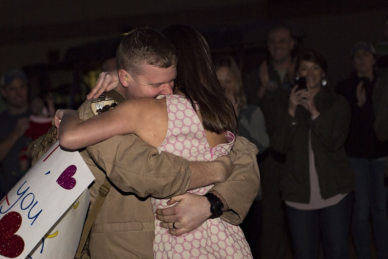 Capt. Ryan Siebert, 74th Fighter Squadron A-10C Thunderbolt II pilot, embraces his spouse, Sarah, during a redeployment, Jan. 23, 2018, at Moody Air Force Base, Ga. Airmen from the 74th Fighter Squadron and 23d Maintenance Group returned home after a seven-month deployment in support of Operation Inherent Resolve. (U.S. Air Force photo by Senior Airman Daniel Snider)
