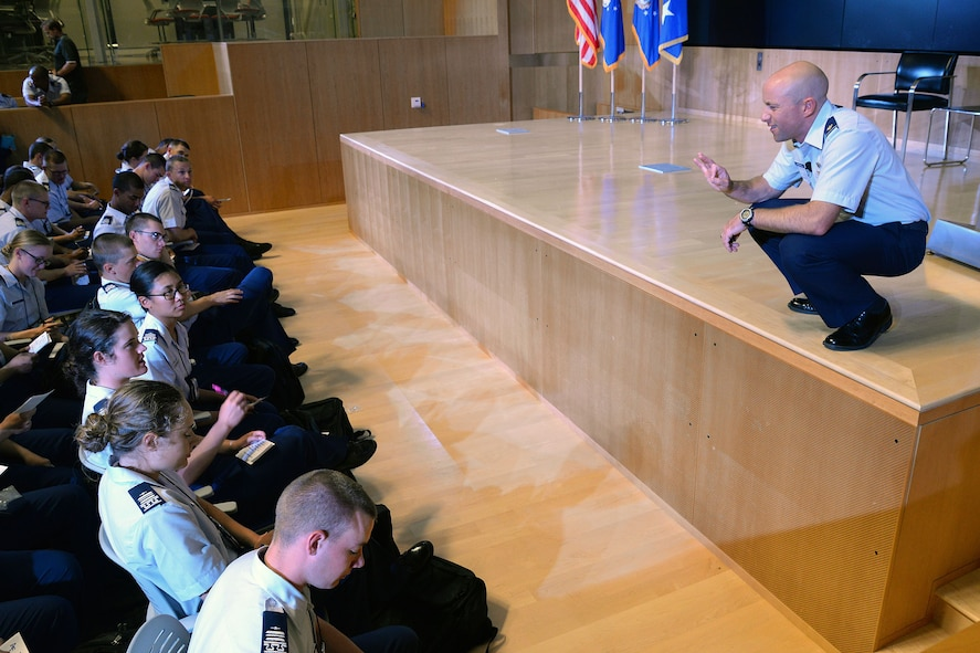 Lt. Col. Robert Marshall, right, Center for Character and Leadership Development director for experiential education programs and honor education, speaks with cadets Aug. 7, 2017, at the U.S. Air Force Academy, Colo. Marshall is currently developing a summer program that encourages cadets to learn and overcome challenges, risk, and failure that can't be replicated in a classroom via outdoor experiences. (Courtesy photo)