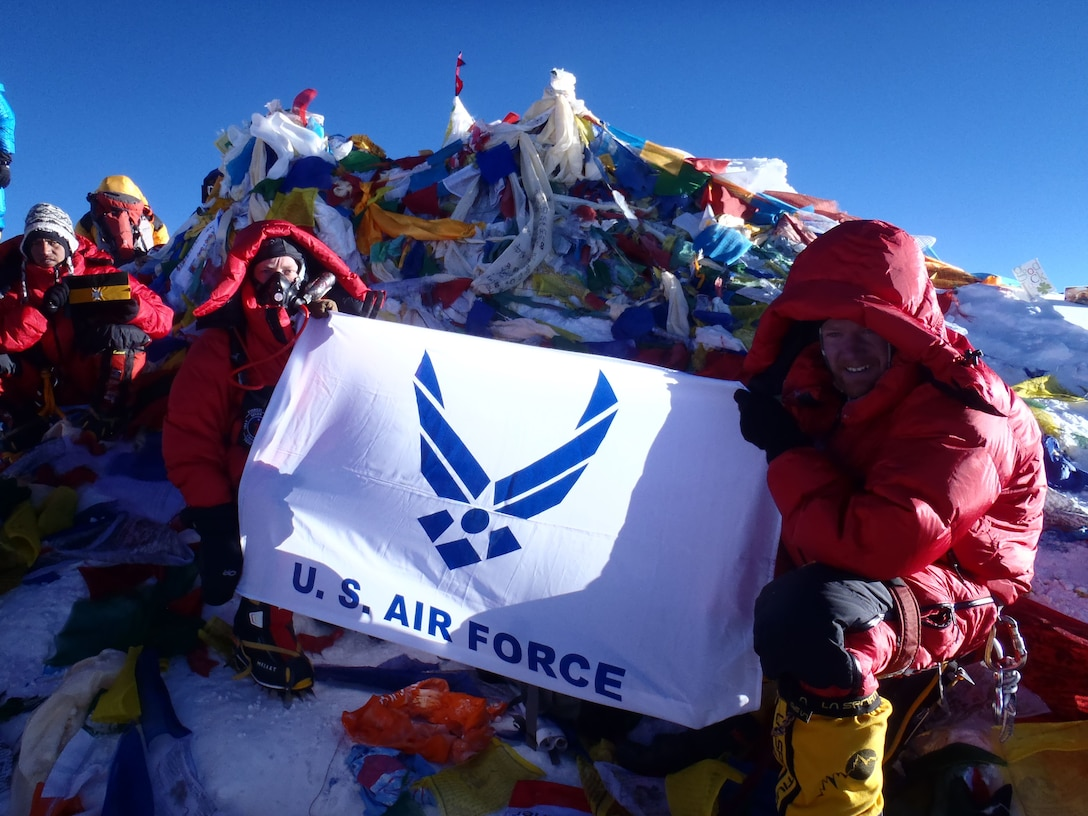 Lt. Col. Robert Marshall, left, Center for Character and Leadership Development director for experiential education programs and honor education, poses for a photo with the Air Force flag May 20, 2013, at the summit of Mt. Everest. Marshall was one of the primary leads for the Air Force Seven Summits team that traveled the world and climbed the highest peaks on each continent. (Courtesy photo)